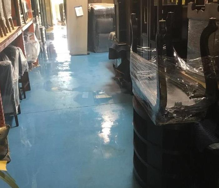 Water damage at a Furniture store Before