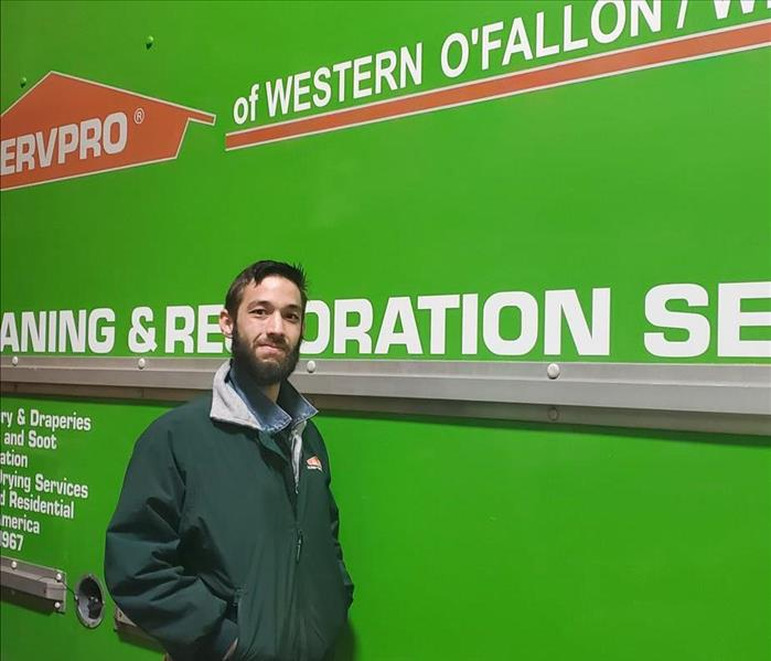 Mark Lane in front of one of our Servpro box trucks with our logo, name and number on it.
