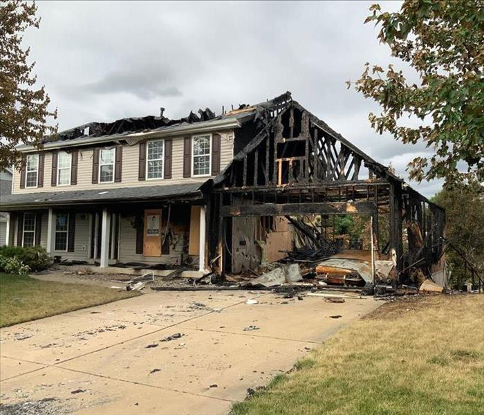 house heavily damaged by fire