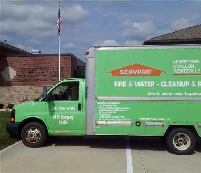 a Servpro of Western O'Fallon/Wentzville truck parked in front of the Wentzville Fire House 1.