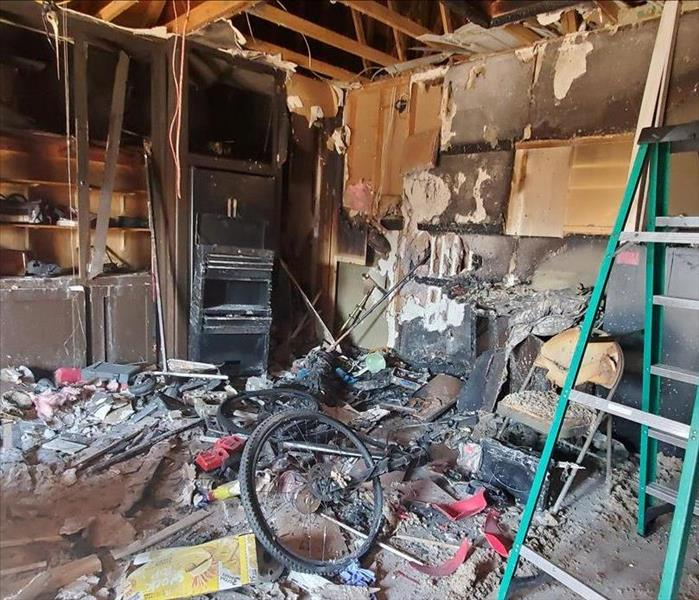 the inside of a garage with all the contents burned up.